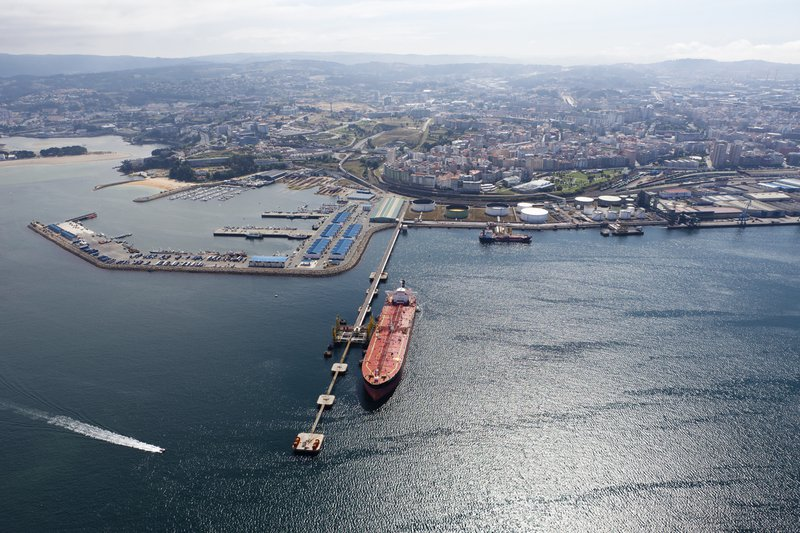 Long-aerial-view-of-oil-tanker-in-port-with-city-behind-186667829_1255x837.jpeg